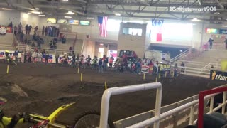 Dirt motocross motorcycle yellow suit kid falls off backwards
