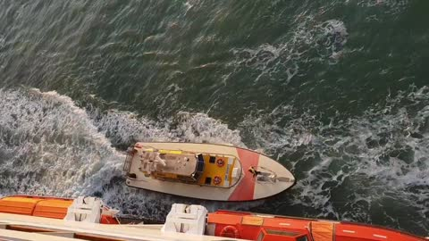 Daring Jump from Ocean Liner to Power Boat
