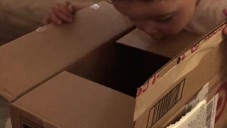 Kid Unimpressed With Christmas Gift