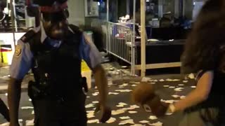 Cop and lady were dancing in festival street food