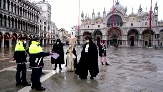 Cancelled Venice carnival marked by masked revellers