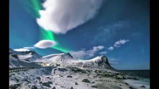 The glow of the north Northern Lights in Norway - man & camera