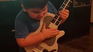 little guitar player
