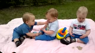 Triplets on their first birthday party.