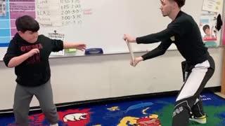 Jump Spinning Hook Kick Break