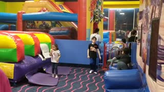 Spencer at @Play bounce house VID_20180520_165332