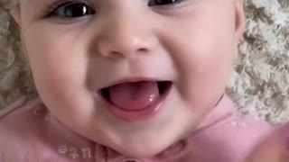 Cute Baby Playing with Mom While Enjoying