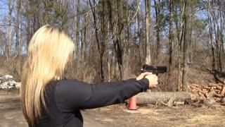 Her first time shooting a handgun!