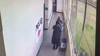 High school coach disarms student with a hug