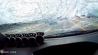 Truck Tire Flings Road Debris through Windshield