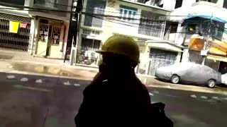 Yangon's protesters flee from tear gas