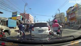 Lane-Splitting Motorcyclist Meets Open Car Door
