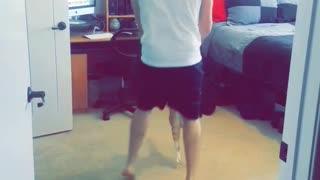 Guy dancing with orange cat in room loud edm music