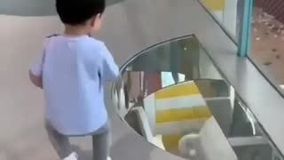 Toddler afraid to cross from glass bridge😅