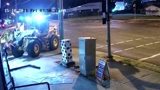 Australian on digger rams shop, steals motorbikes