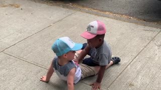 """Toddlers run to hug each other and yell, """"My friend!"""""""