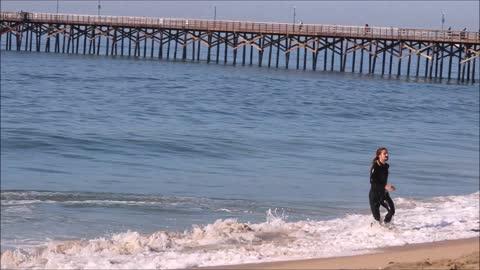 Professional Skimboarder Austin Keen hitting some waves in Seal Beach California.