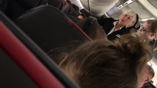 Laptop Sent Flying in Airplane Altercation