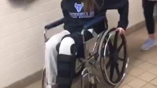 Girl broken leg wheel chair falls backwards wheelie