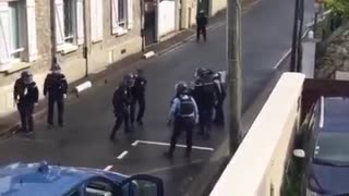 Brave Police officer takes down armed woman