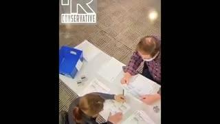 Poll worker filling out Biden Ballots