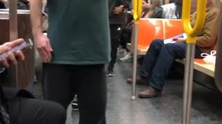 Drunk guy spins around fast inside a subway train