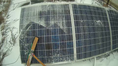 Clearing Solar Panels of Snow. A winter morning in OffGrid life.