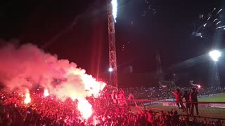 Indonesian Soccer Supporters Celebrate The Trophy Winning With Fireworks and Flares