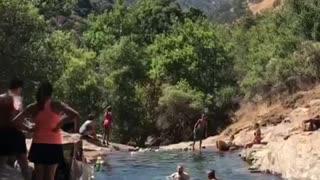 Group of people at river man falls