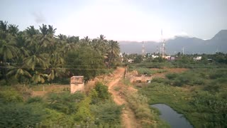 Scenic Beauty of Village from inside of a moving train