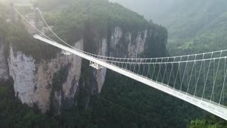 Bungy jump from the world's highest glass-bottom bridge