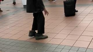 Old man dancing to music subway station