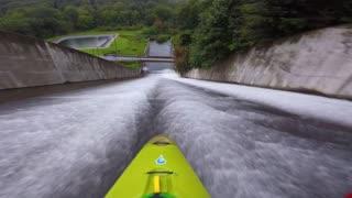 Kayaker Paddles Down Slide