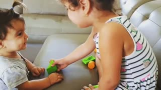 Baby sisters get into super cute squabble
