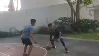 Kid in black throws basketball hits face