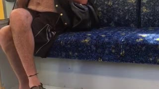 Man casually plays flute on subway train