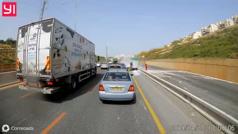 Moped riders collide while trying to cut traffic on the shoulder