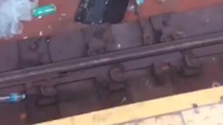 Broken computer on subway tracks